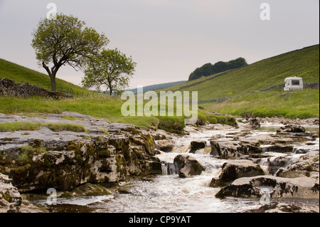 Campervan by River Wharfe, flowing through quiet scenic narrow valley, cascading over limestone rocks - Langstrothdale, - Stock Photo