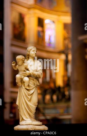 Mother Mary and baby Jesus statue inside the Santa Maria Assunta Church, Pisa, Tuscany Italy - Stock Photo