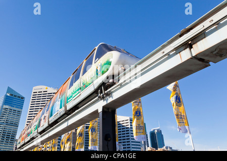 A Metro Monorail train at Darling Harbour, Sydney, Australia with the CBD in the background. Some motion blur on - Stock Photo