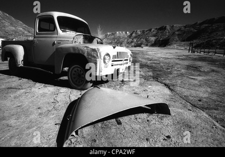 Left behind an abandoned truck in the Badlands, Alberta, Canada. Very little deterioration because of the dry, arid - Stock Photo
