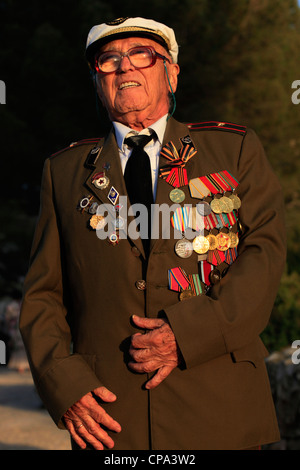A soviet Jewish World War II veteran with medals pinned in his old uniform during ceremony marking the Allied Victory - Stock Photo