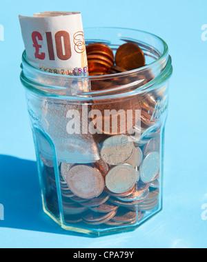 Savings in a jam jar - Stock Photo