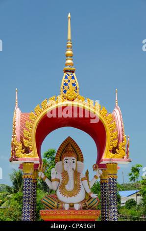 Thailand, Ko Samui (aka Koh Samui). Wat Plai Laem, Buddhist temple. Golden temple shrine. - Stock Photo