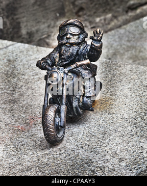 These little bronze sculptures of fairy-tale gnomes are far from the tourist-industry icons that they first appear - Stock Photo