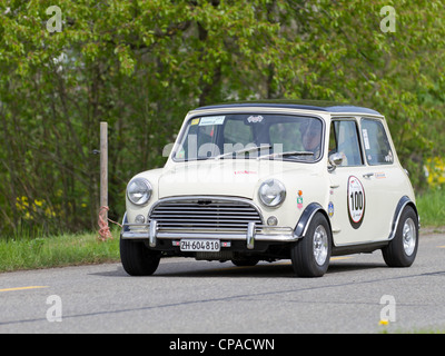 Vintage race touring car Morris Mini Cooper S from 1969 at Grand Prix in Mutschellen, SUI on April 29, 2012. - Stock Photo