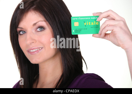Woman showing French Carte Vitale - Stock Photo