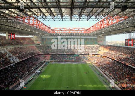 The San Siro stadium during an AC Milan football game - Stock Photo