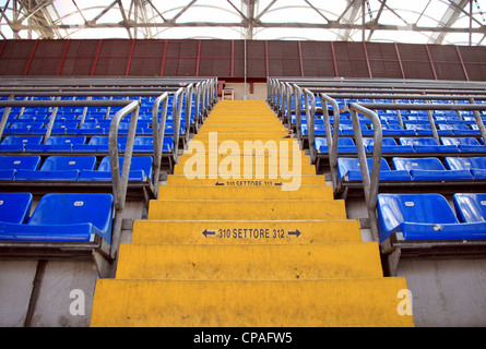 Blue stadium seats at San Siro Stadium in Milan, Italy - Stock Photo