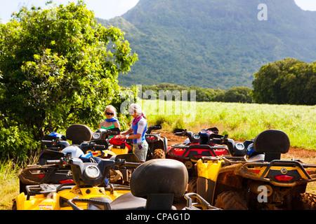 Kauai, Hawaii, USA. An ATV adventure though Kipu Ranch on Kauai, Hawaii. The Ha'upu mountain range is in the background. - Stock Photo