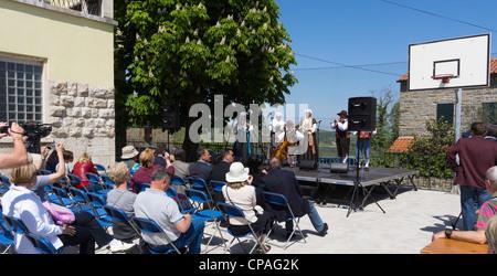 Padna, Slovenia, village with seasonal olive oil wine and farm produce festivals - folk music concert during festival. - Stock Photo