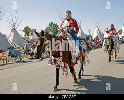 USA, Montana, Crow Agency. Participants taking part in a parade held during the annual Crow Fair in Crow Agency, - Stock Photo