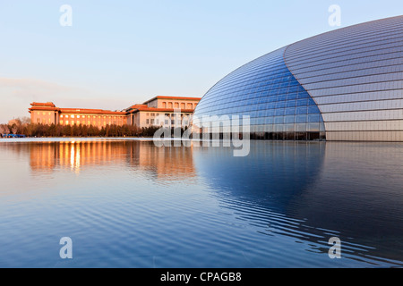 National Centre for the Performing Arts, Beijing, China and the Great Hall of the People at sunset. - Stock Photo