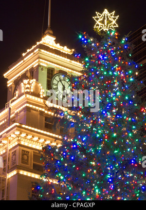 USA, Oregon, Portland, Christmas Tree on a snowy night in Pioneer ...