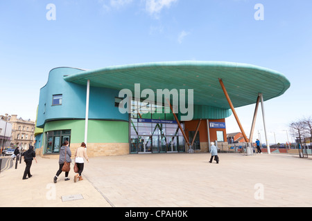The entrance to Barnsley Interchange, South Yorkshire, England, and people walking towards it. - Stock Photo