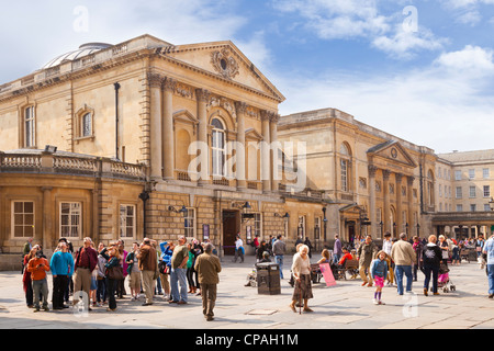 Crowds in front of the Roman Baths in Bath, Somerset, England, on a bright sunny day. - Stock Photo