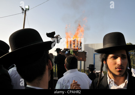 Ultra orthodox men pray at the grave site of Rabbi Shimon Bar Yochai at the holiday of Lag Baomer - Stock Photo