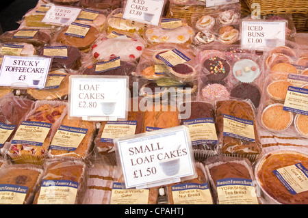 Assorted cakes on sale at Stokesley Farmers Market, North Yorkshire, England, UK - Stock Photo
