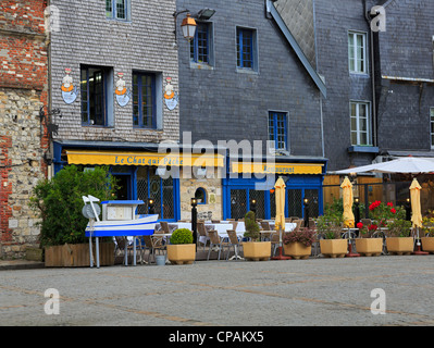 The historic fishing village of Honfleur, France. Restaurants on the wharf of the old fishing port in Normandy. - Stock Photo