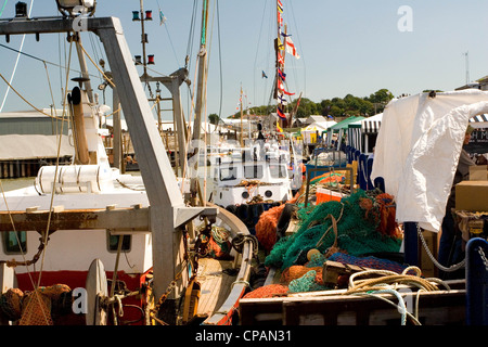 Boats and market stalls in Whitstable Harbour, Kent, England, UK - Stock Photo