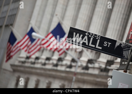 Wall Street sign in front of New York Stock Exchange in Manhattan, New York City - Stock Photo