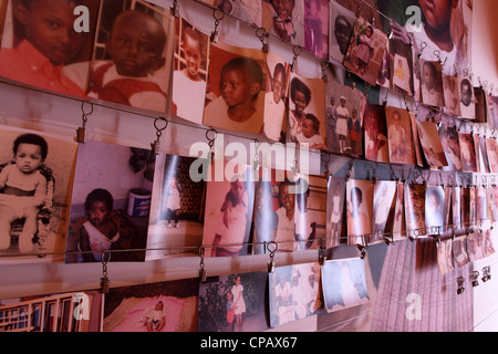 Photographs of young genocide victims at the Kigali Memorial Centre in Kigali, Rwanda. - Stock Photo
