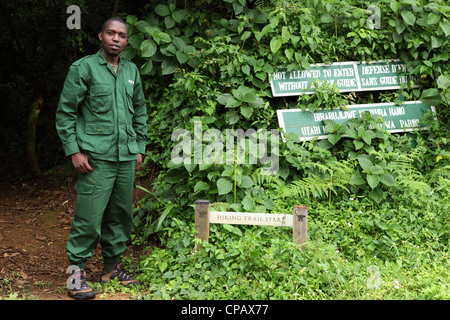 A naturalist and guide by the start of the Isumo Trail in Nyungwe National Park, Rwanda. - Stock Photo