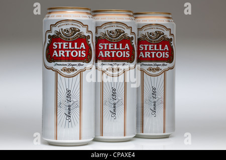 Three cans of Stella Artois lager - Stock Photo