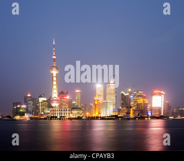View at night of cityscape and skyscrapers of Pudong district of Shanghai in China - Stock Photo