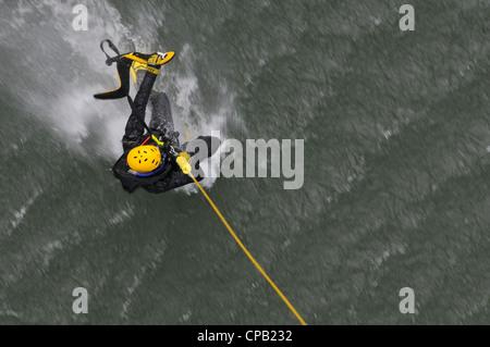 A North Carolina Army National Guard UH-60 Black Hawk helicopter rasies Paramedic George Ross during a North Carolina - Stock Photo