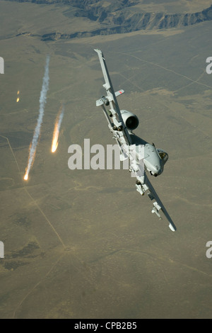 An Idaho Air National Guard A-10, Thunderbolt II, from the 190th Fighter Squadron, Boise, Idaho fires off flares - Stock Photo