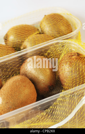 close up of a kiwi fruits in plastic container - Stock Photo