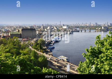 Kiev the capital of Ukraine, city landscape on river, bridge, and buildings - Stock Photo