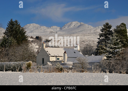 A Scottish country house in a snowy winter landscape with distant hills, Killin, Scotland - Stock Photo