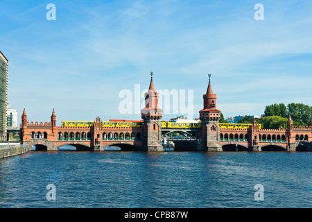 oberbaumbruecke bridge with subway passing over the pree river in berlin germany - Stock Photo