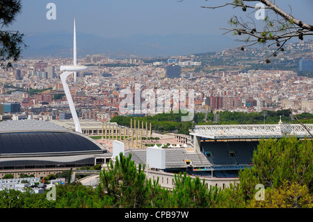 Palau Sant Jordi (St. George's sporting arena) and Montjuïc Communications Tower in the Olympic park in Barcelona, - Stock Photo