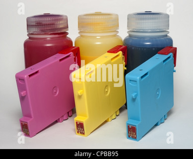Ink cartridges and bottles of refill - Stock Photo