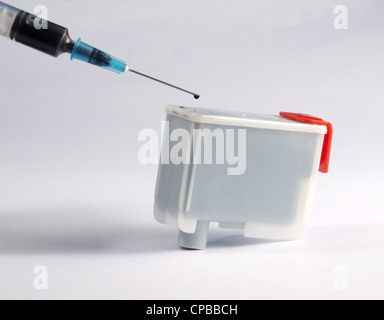 Refilling black ink cartridge - Stock Photo