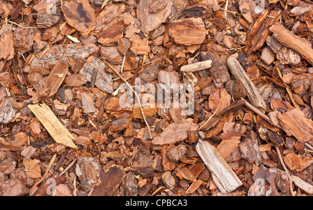 Wooden mulch outside in the garden, very textured - Stock Photo
