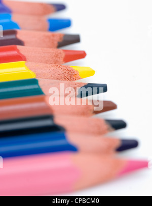 Macro View of a row of colourful drawing art pencils. - Stock Photo