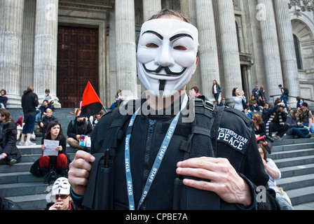 Occupy, London UK. Anti capitalism demonstration, part of a global day of action. Protester in anonymous Guy Fawkes - Stock Photo