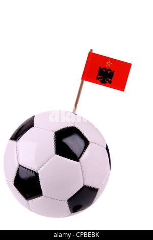Soccerball or football decorated with a small national flag on a toothstick - Stock Photo