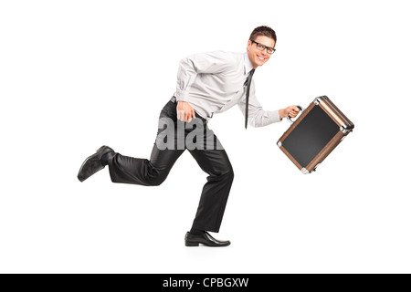A businessman running with a briefcase isolated against white background - Stock Photo