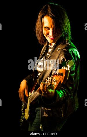 Rock Woman Playing Electric Bass Guitar