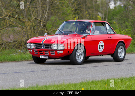 Vintage race touring car Lancia Fulvia 1.3S from 1972 at Grand Prix in Mutschellen, SUI on April 29, 2012 - Stock Photo
