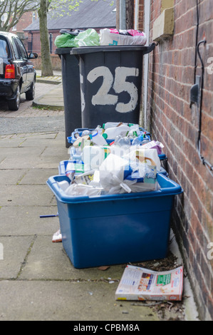 Overflowing recycle and landfill bins - Stock Photo