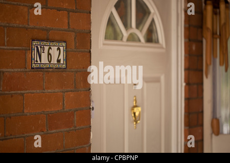 No 62 tile identification for flat / house. - Stock Photo