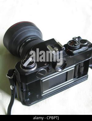 Old 35mm SLR Camera - Stock Photo