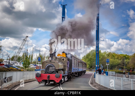 A vintage steam train from the Ribble Steam Railway in the old Preston docks. - Stock Photo