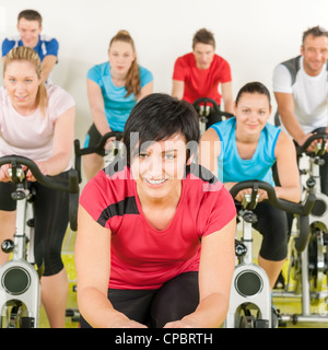 Fitness group of people on bicycle doing spinning at gym - Stock Photo