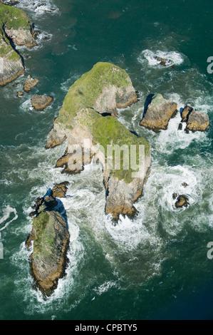Aerial of offshore rocks, Pacific Coast, Chiloe Island, CHILE : Habitat for endangered Marine Otter (Lontra felina) - Stock Photo